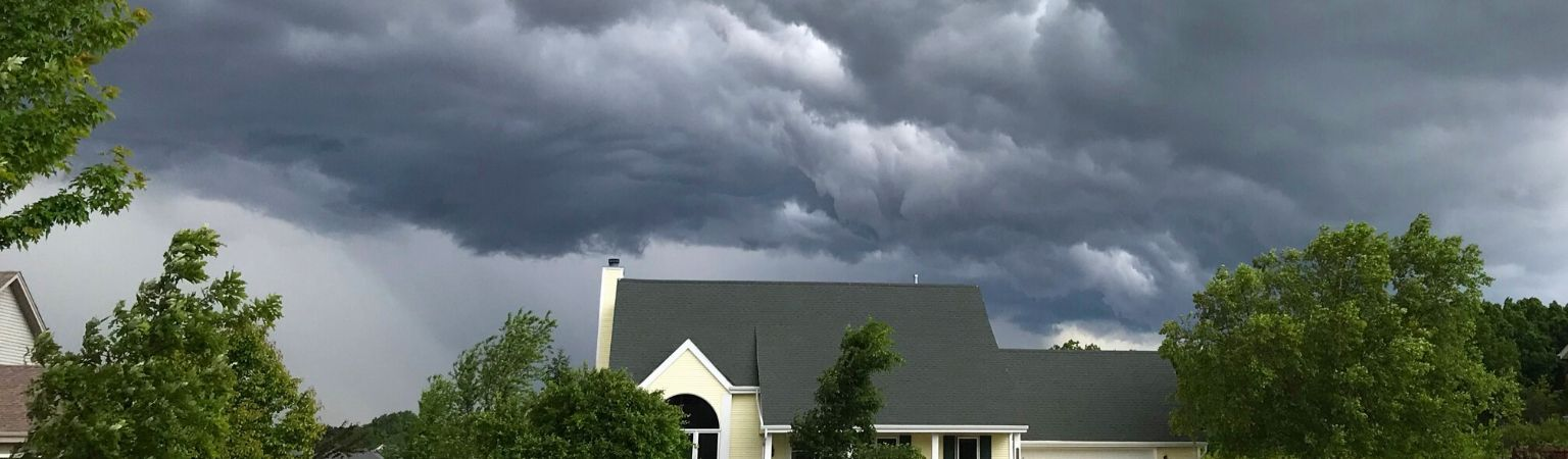 Storm in the sky above a house