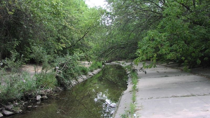 concrete lined kinnickinnic river in Jackson Park