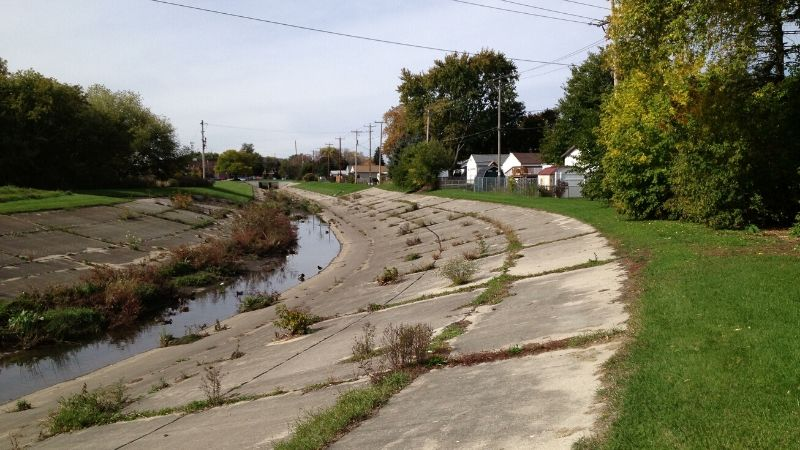 concrete lined kinnickinnic river in wilson park creek